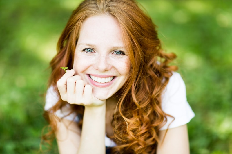red haired woman relaxing outdoors