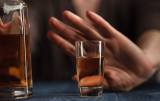 woman refused a glass of whiskey