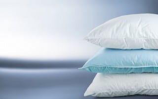 3 pillows stacked on top of each other. Your pillow may be soft and feathery, just how you like it as you sleep, but if it's too fluffy, too soft or too firm, your spine is probably out of alignment and you're more likely to snore.