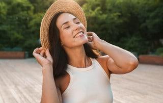 cute woman enjoying the beautiful sunshine